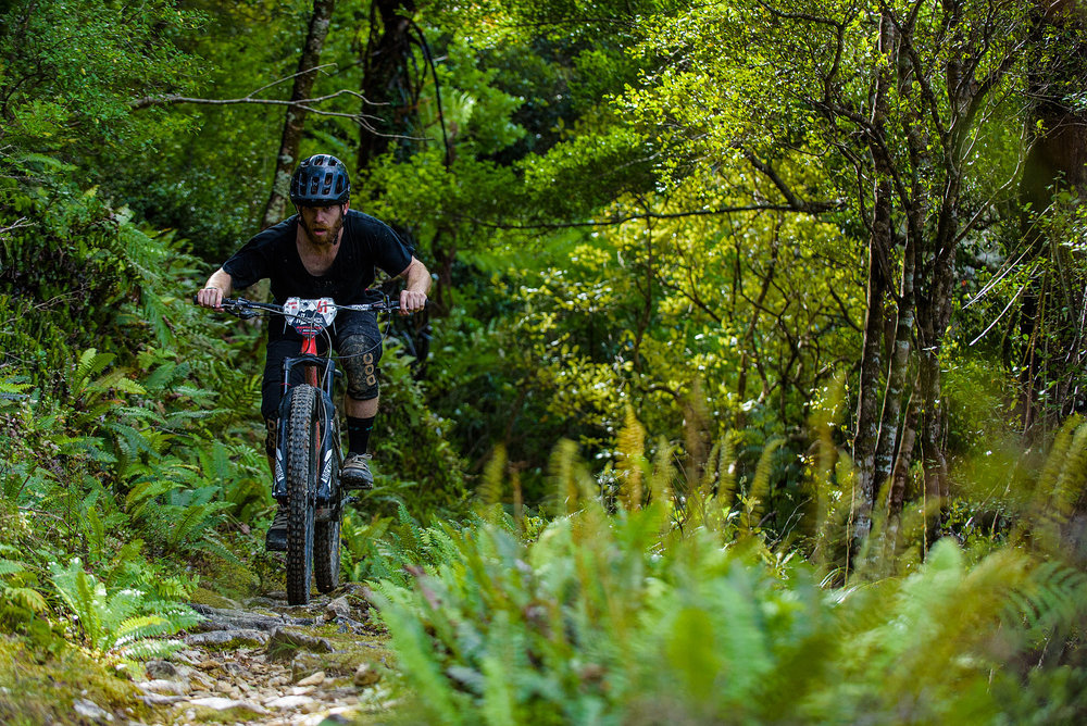 NZ enduro is hard. The stages are long and physical with big root-balls and pinball rocks. Mat Hunt and Odin Woods we're the only riders out of 140 game enough to ride hard tails. This is Mat Hunt trying to ignore the pain in his legs.