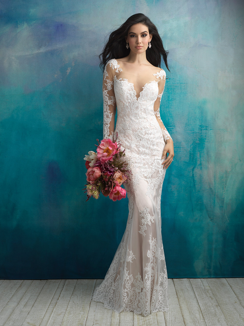 Style 9506 - Winding vines and flowers cover the sheer illusion sleeves of this lace sheath.