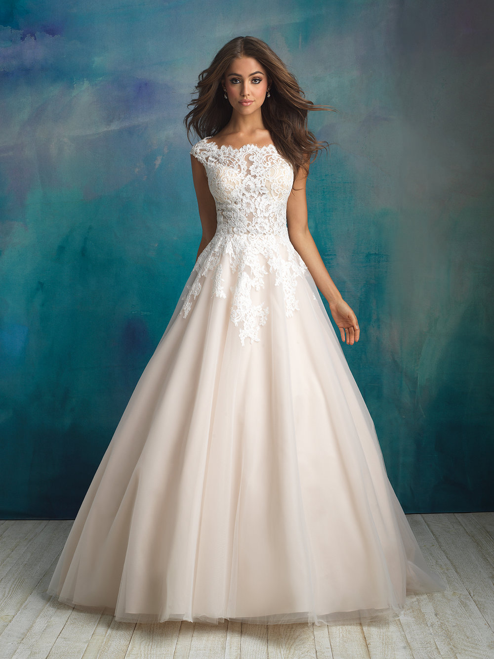 Style 9520 - A bateau neckline and delicate cap sleeves compose the bodice of this tulle ballgown.