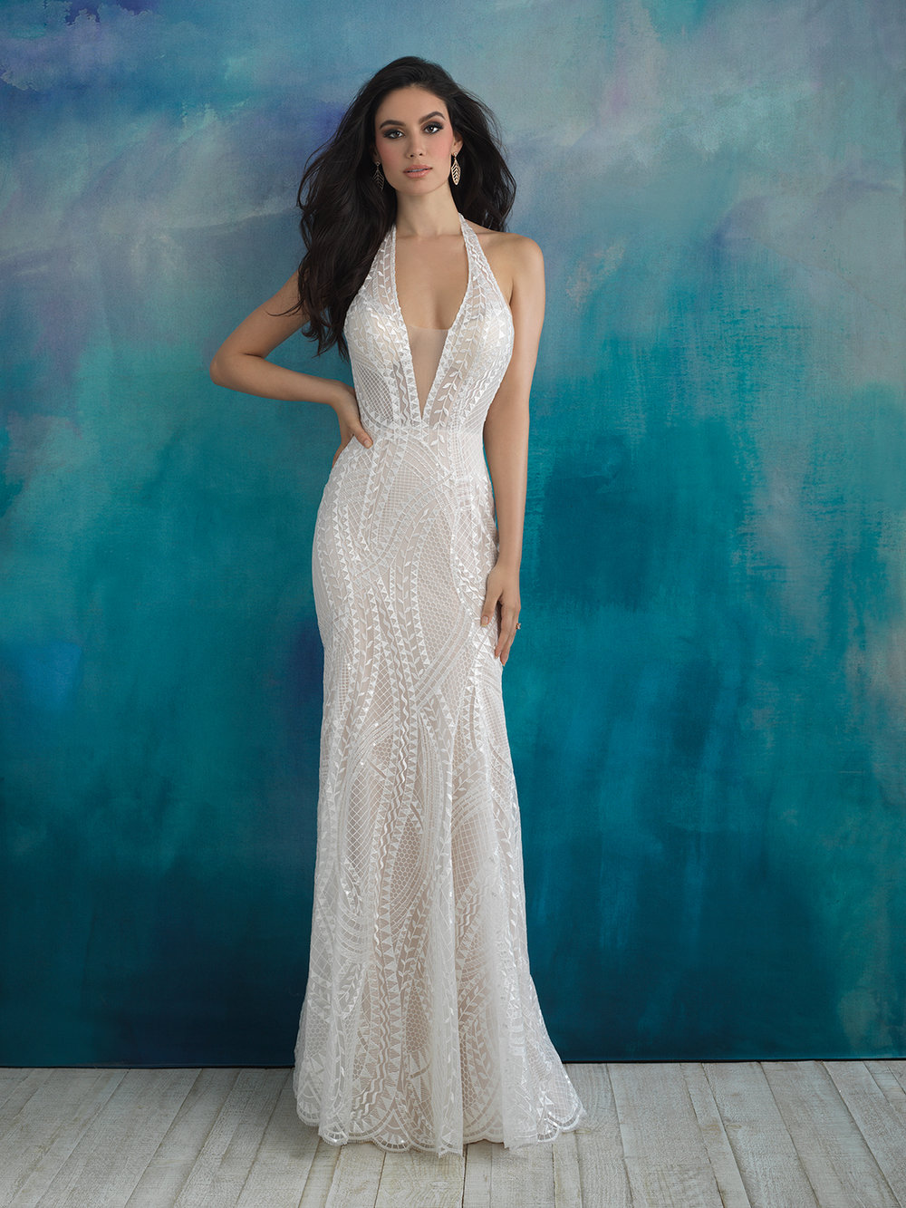 Style 9522 - The overskirt of this halter gown is embroidered with intertwining vines and geometric patterns.