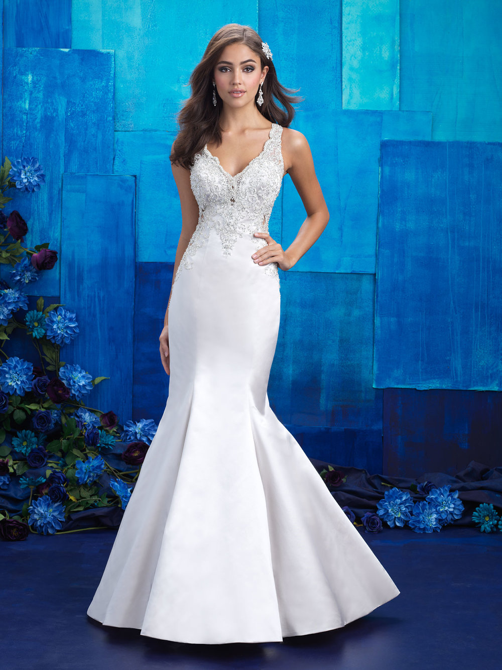 Style 9402 - The open illusion back of this gown is softened by swirls of beaded appliques and floating buttons.