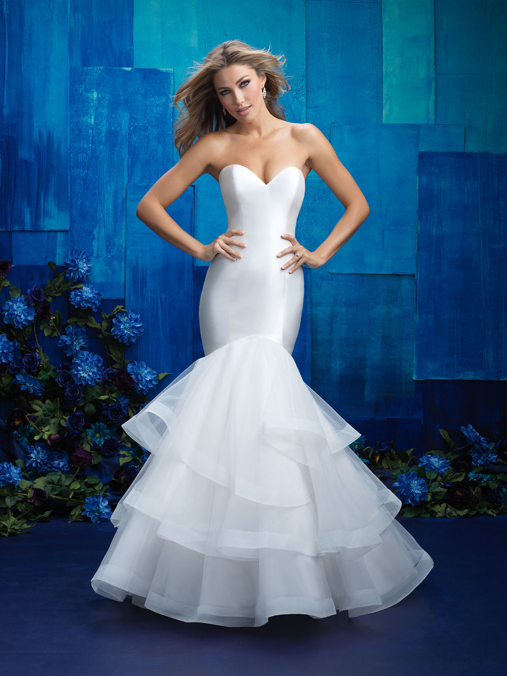 Style 9416 - A smooth satin finish paired with tiered ruffles lends itself to a truly statuesque strapless gown.