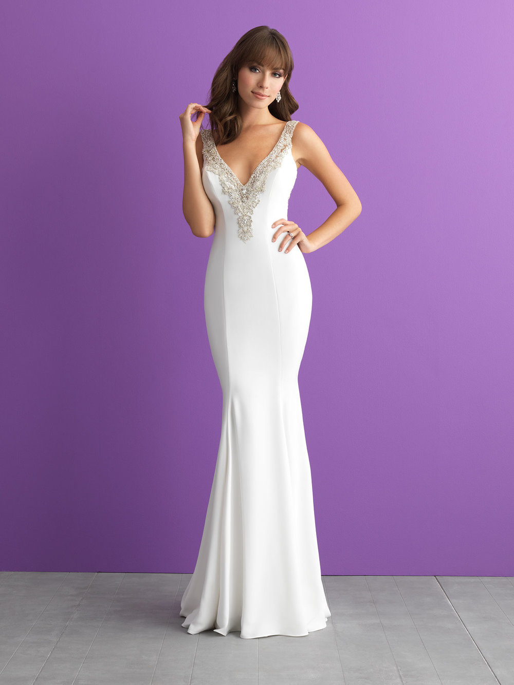 Style 3013 - Softly clinging fabric is paired with an eye-catching neckline and open back in this truly glamorous look.