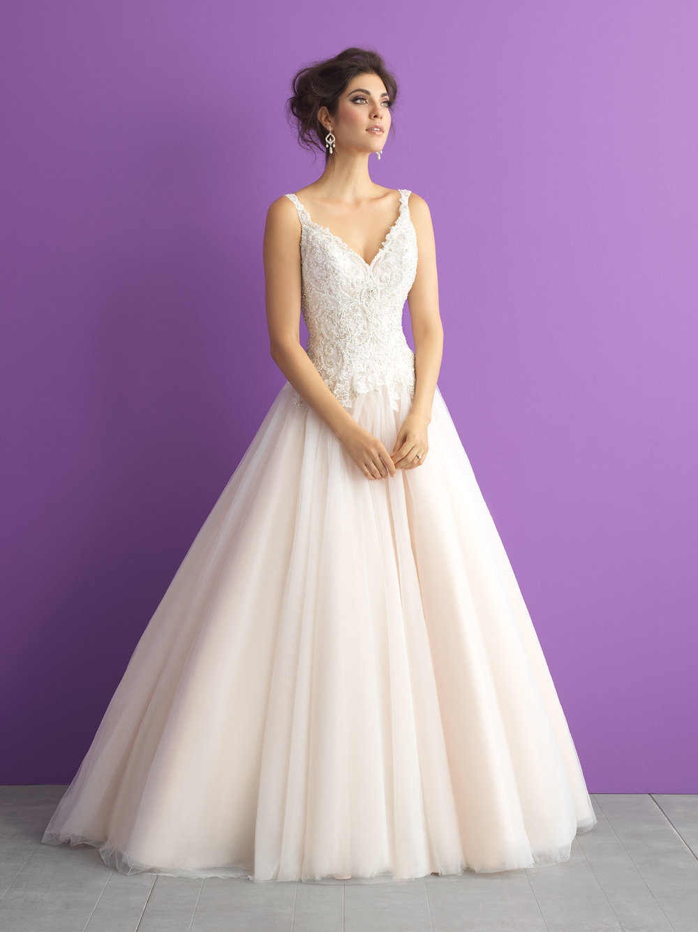 Style 3015 - A decadent beaded bodice offsets the simple skirt of this sleeveless ballgown.