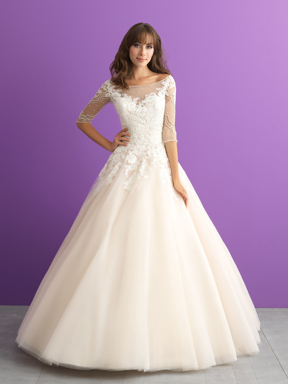 Style 3006 - This lace-topped ballgown features a bateau neckline and elbow length sheer sleeves.