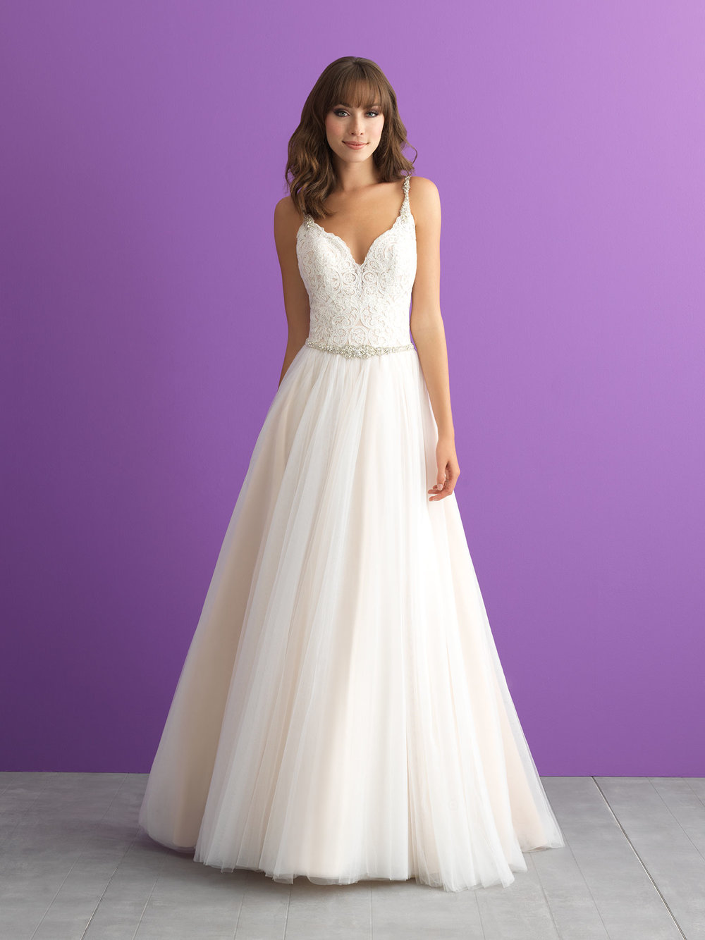 Style 3004 - Sometimes the simplest gowns have the prettiest details - like beaded straps, a scooped back and layers of tulle.