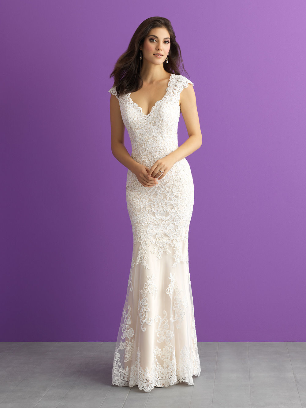 Style 3009 - Silk charmeuse adds a shimmering contrast to this lace sheath.