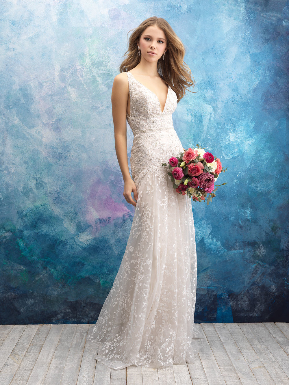 Style: 9572 - A wealth of textures draws the eye to this airy, sleeveless gown.