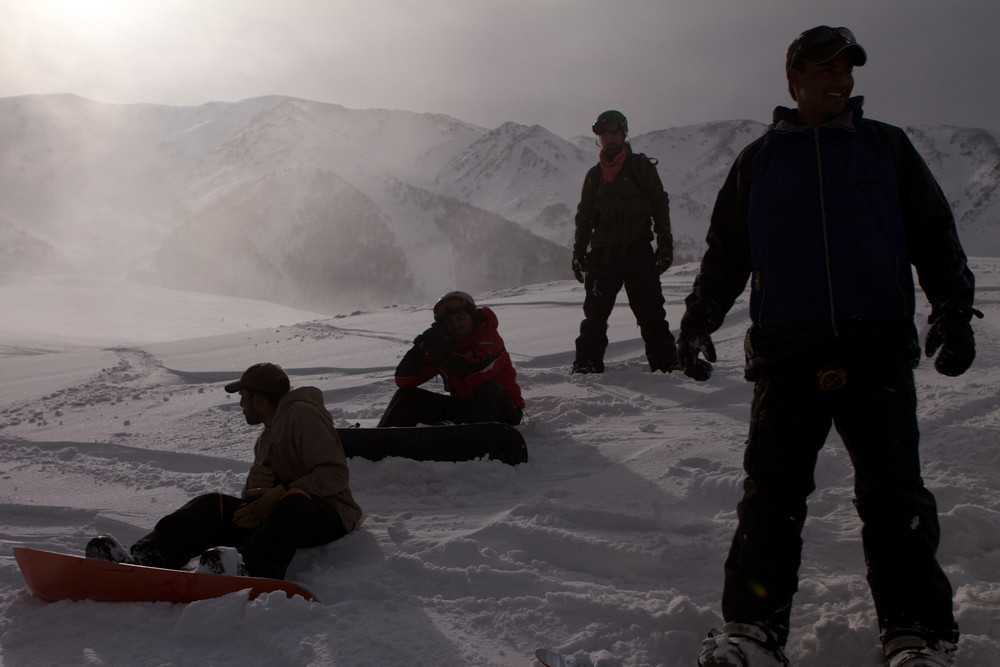 A crew of friends finishing a day on the hill as the sun gets low over Mt Affarwat.