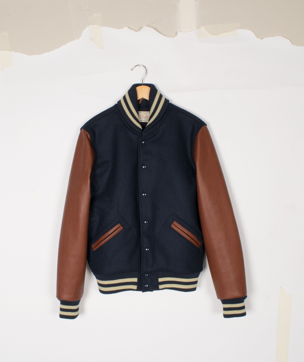 Varsity Jacket - Dark Navy/Brandy - $285/$575