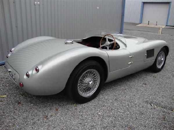 Sold.  Finished in XK silver with red leather trim. Fitted with Brooklands Racing Screens and cut-away screen.
