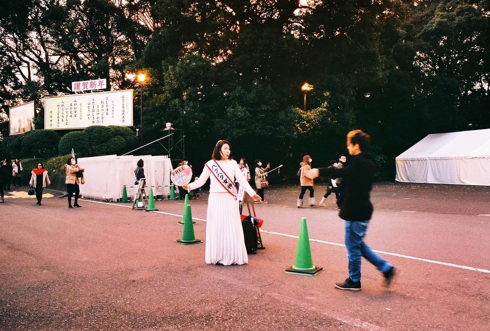 Divine Tio Hugs Lady Meiji Shrine Tokyo Japan - Atis Puampai
