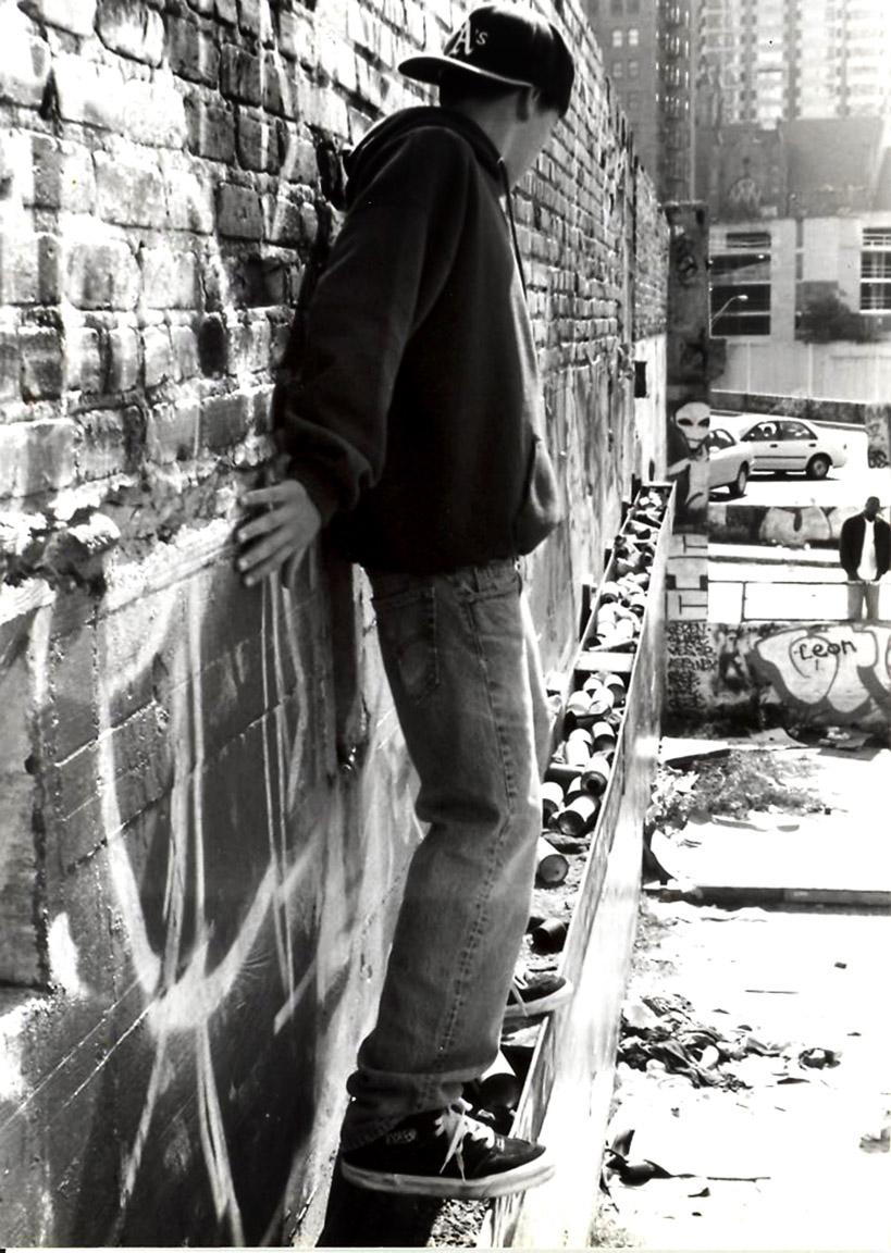 YELAWOLF SCALING GRAFFITI WALL