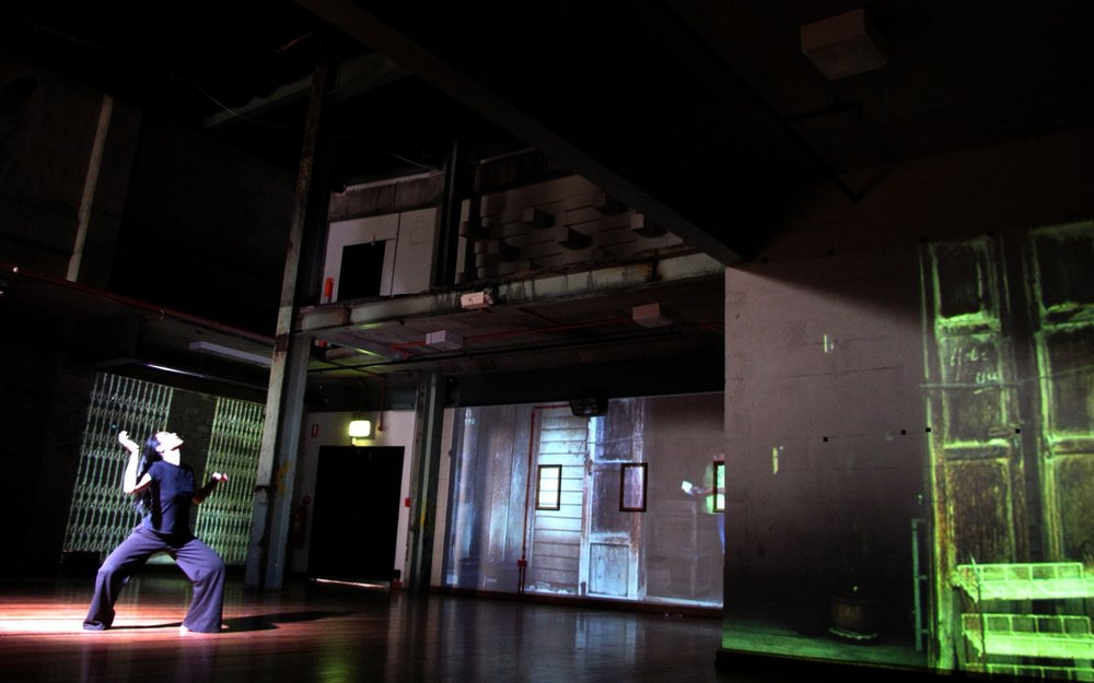 Scene from  The Borrowed Language  with Kobie's video mapping projections