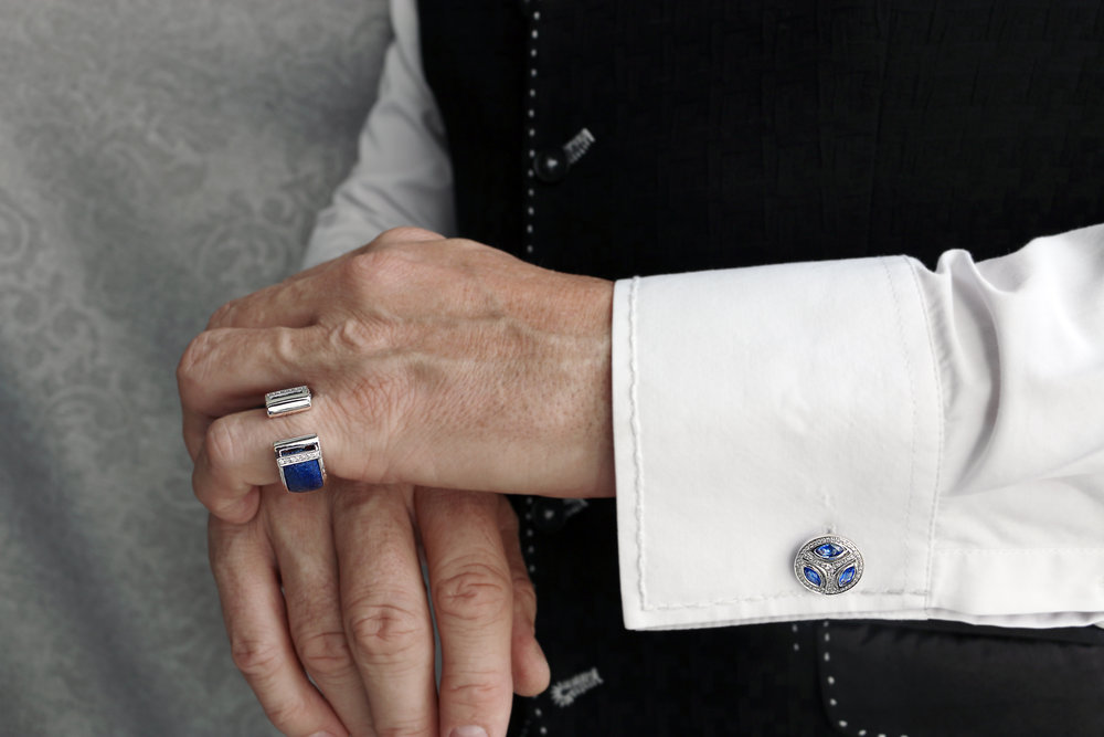 Damian By Mischelle ring, set with 18K white gold, ostrich leather and diamonds. Damian By Mischelle cufflinks, set with 18K white gold, blue sapphires and diamonds