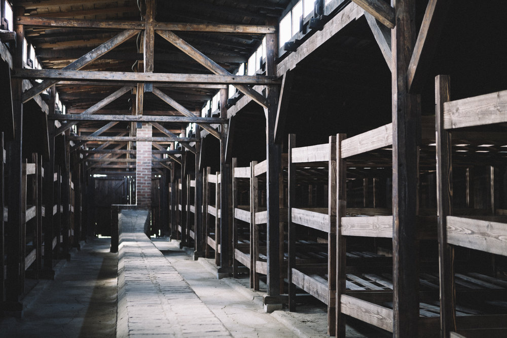 Three tier wooden bunks intended for 15 prisoners to sleep in were installed in the Birkenau stalls, sometimes the bunks ended up sleeping 18/21 prisoners. The total capacity per barracks was more than 400 prisoners.
