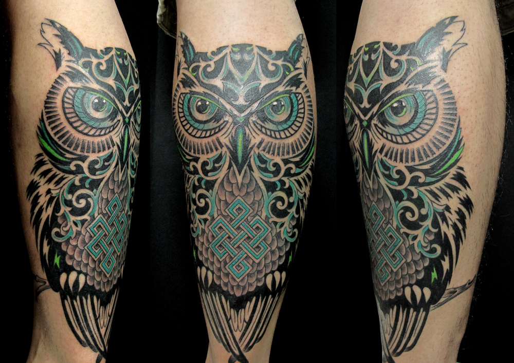 tribal owl on calf.jpg