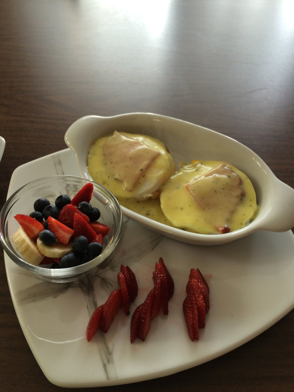 Eggs Benedict and Seasonal Fruit Cup