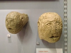 Replicas of the St Piran Oratory carved heads on display at the Royal Cornwall Museum (women on left, man on the right) (credit: Tom Goskar, reproduced by kind permission of the Royal Cornwall Museum)