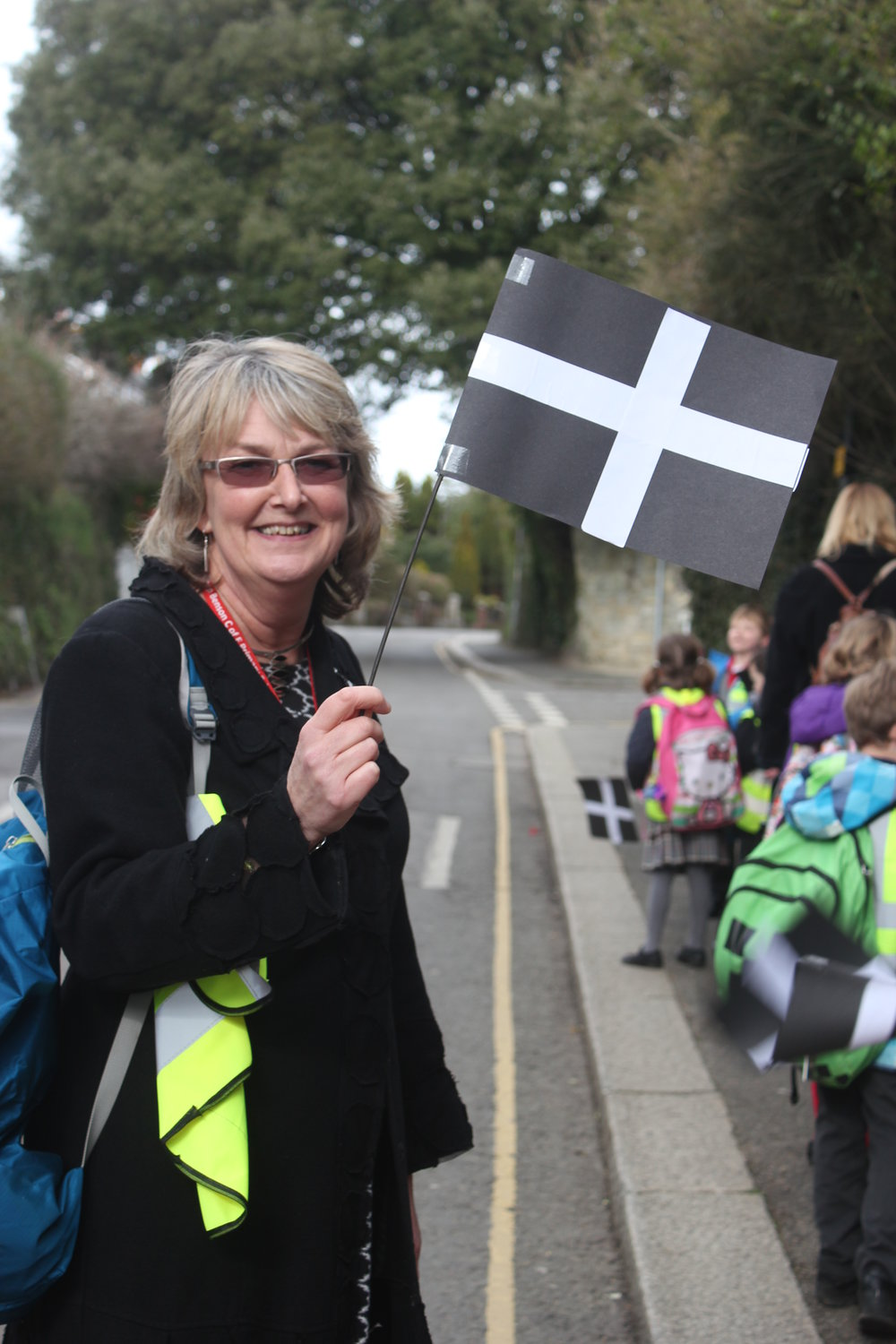 Mrs Teasdale, proudly flying the Cornish flag, as she leads her children on the St Piran's Day Parade.