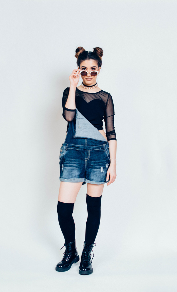 Overalls: Amazon.com. Black mesh top: Forever 21. Thigh-high socks: Boscovs. Choker: Etsy. Sunglasses: Express. The boots were the ones Lexi wore to the shoot.