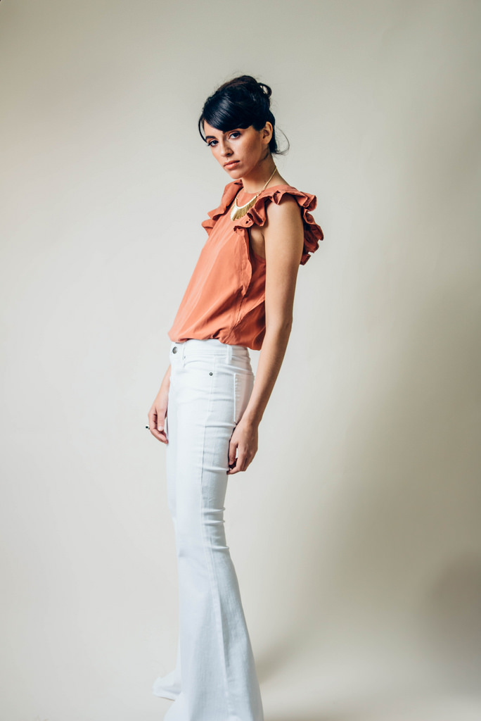 White Denim Super Flares by Free People.  Louisa Ruffle Tank in Rust  by Free People. Shoes, model's own.  Metal Stick Fringe Necklace  by Express.