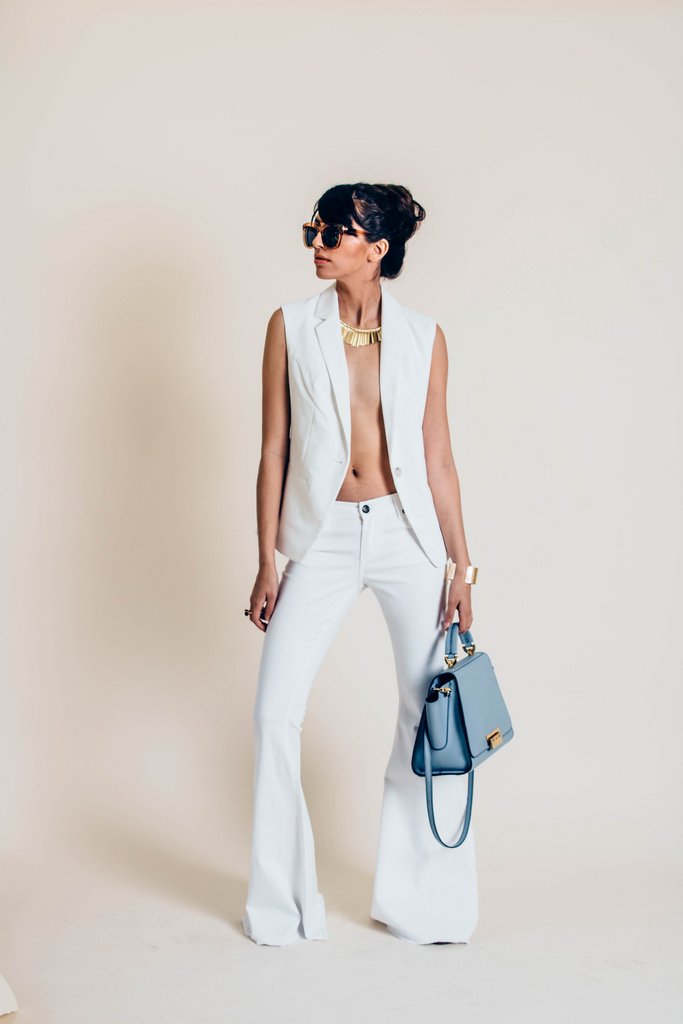White Denim Super Flares  by Free People.  Zac Posen Blue Eartha Handbag .    Metal Stick Fringe Necklace  by Express. White Sleeveless Blazer, stylist's own.  Ombre Tortoiseshell Cat-Eye Sunglasses  by Express.