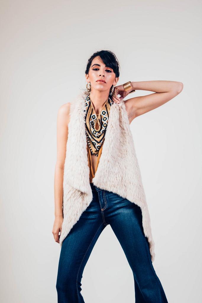 Ella Denim Super Flares  by Free People.  Suki Embellished Bandana  by Free People.  Halter Low-V Bodysuit in Honeycomb  by Free People.   Beige Rabbit Fur Vest by Jocelyn.
