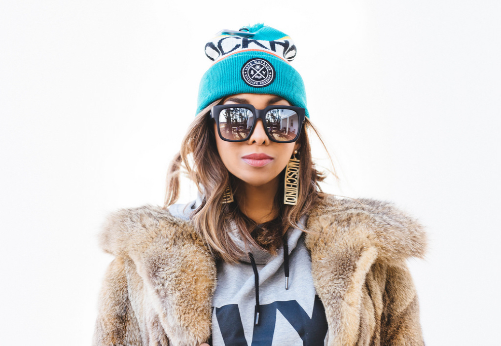 Stockholm Sweden Beanie. Ivy Park Hoodie. Both items from Topshop and available in my online shop. Vintage fox fur coat from Milk & Ice Vintage. Moschino logo earrings from Poshmark. Sunglasses by Quay Australia.