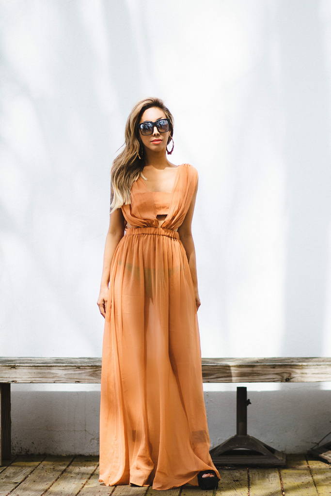 Gathered Ruched Chiffon Maxi Beach Dress: ASOS. Strapped Black Platform Sandals: Jeffrey Campbell. Green Hipster Bikini Bottom: PacSun. Gold Bamboo Earrings: Urban Outfitters. On The Prowl Sunnies: Quay Australia.