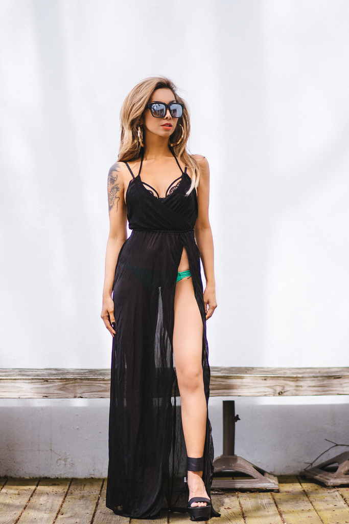 Sheer chiffon beach dress with super high slit: Asos. Green hipster bikini bottoms: Pacsun. Black lace bralette: Free People. Black strapped platforms: Jeffrey Campbell. Sunnies: Quay Australia. Hair by Sarah Vitek for Edge Evolution Studio & Spa.
