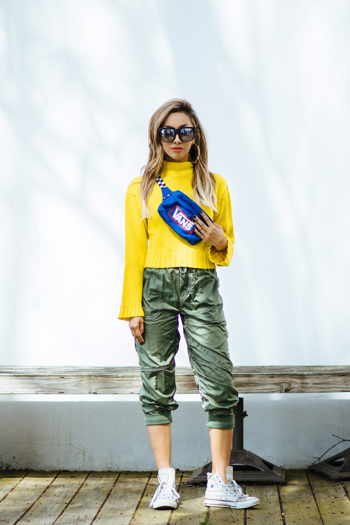 Chartreuse Chunky Sweater: ASOS. Old Skool Belt Bag: Vans. Without Walls Jane Tech Parachute Pants: Urban Outfitters. White High-Tops: Converse. On The Prowl Sunnies: Quay Australia.