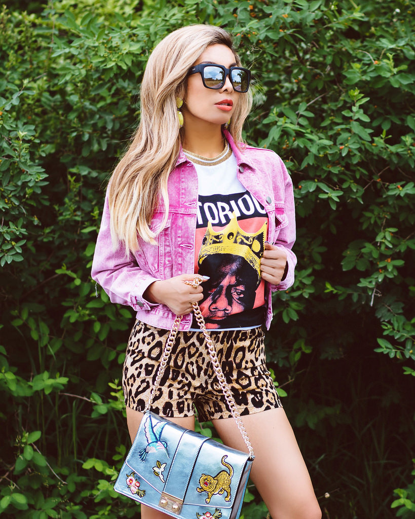 Blue metallic crossbody bag with patches: ASOS. High-waisted shorts in leopard print: Tripp NYC. Oversized tee with Notorious BIG: ASOS. Denim jacket in pink acid wash: ASOS Petite. Lime green drop earrings: Bauble Bar. On The Prowl sunnies: Quay Australia. Nails by Impress Manicure.