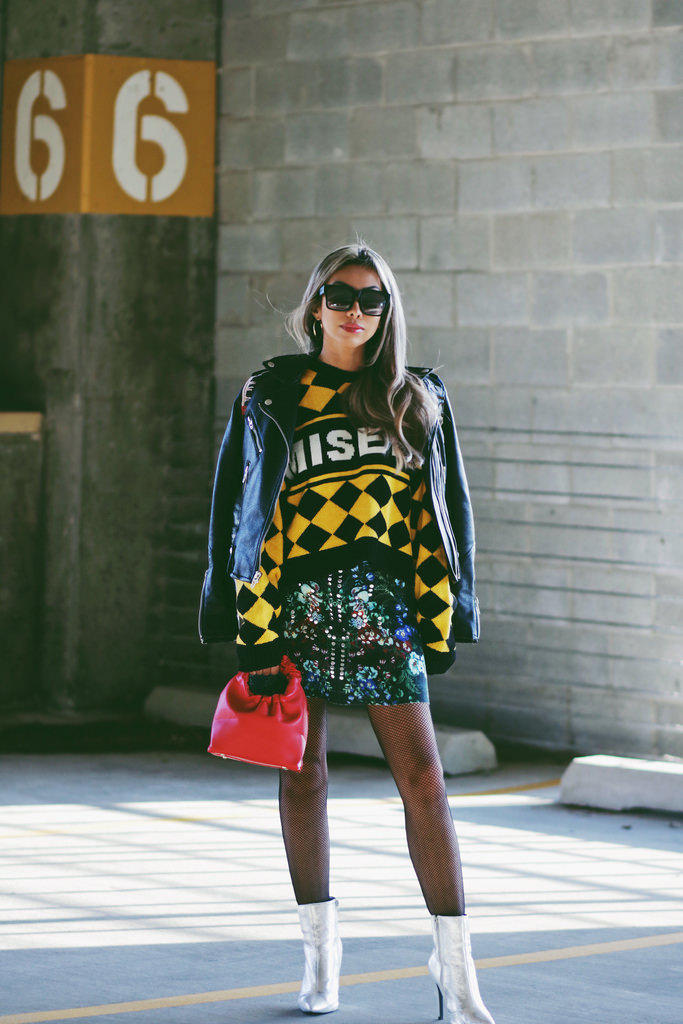 Yellow checked sweater by The Ragged Priest. Floral embellished scuba miniskirt by ASOS. Black embellished leather jacket by Blank NYC. Silver metallic boots by ASOS. Red leather fortune cookie handbag by Le Accessories. Black fishnet tights from Amazon.