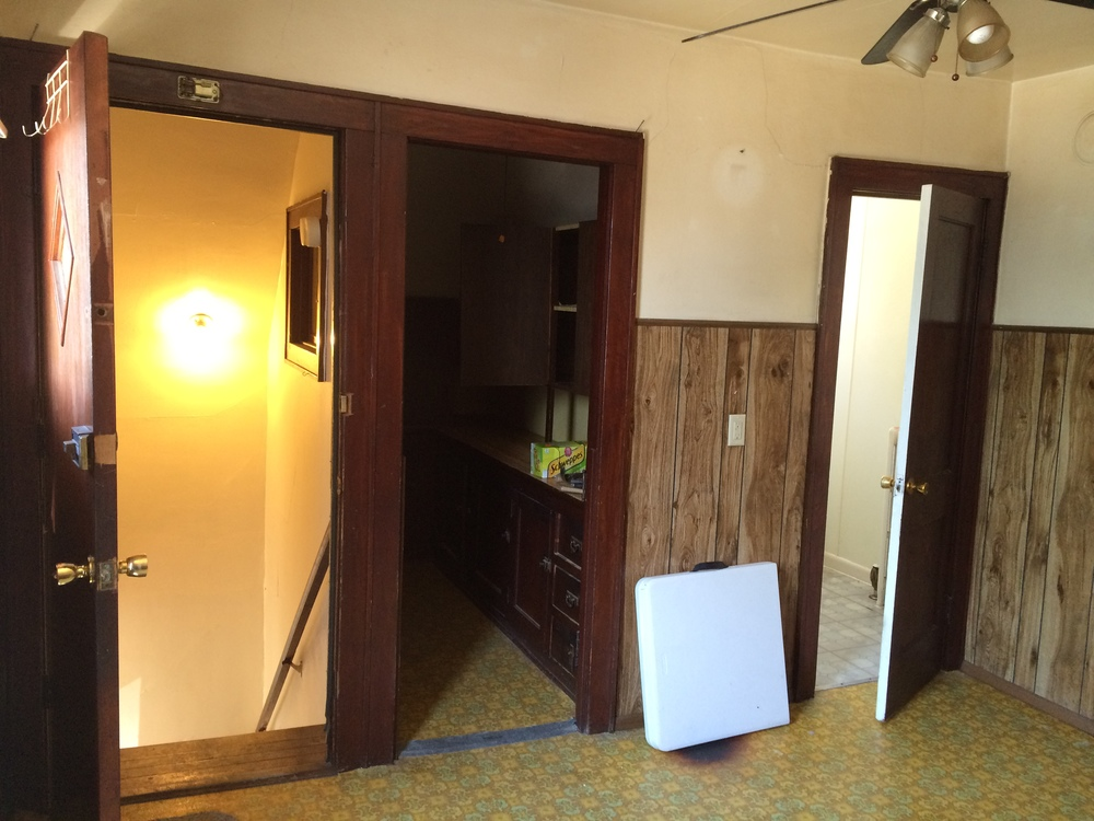 kitchen west wall. stair entry. pantry door. bathroom door.