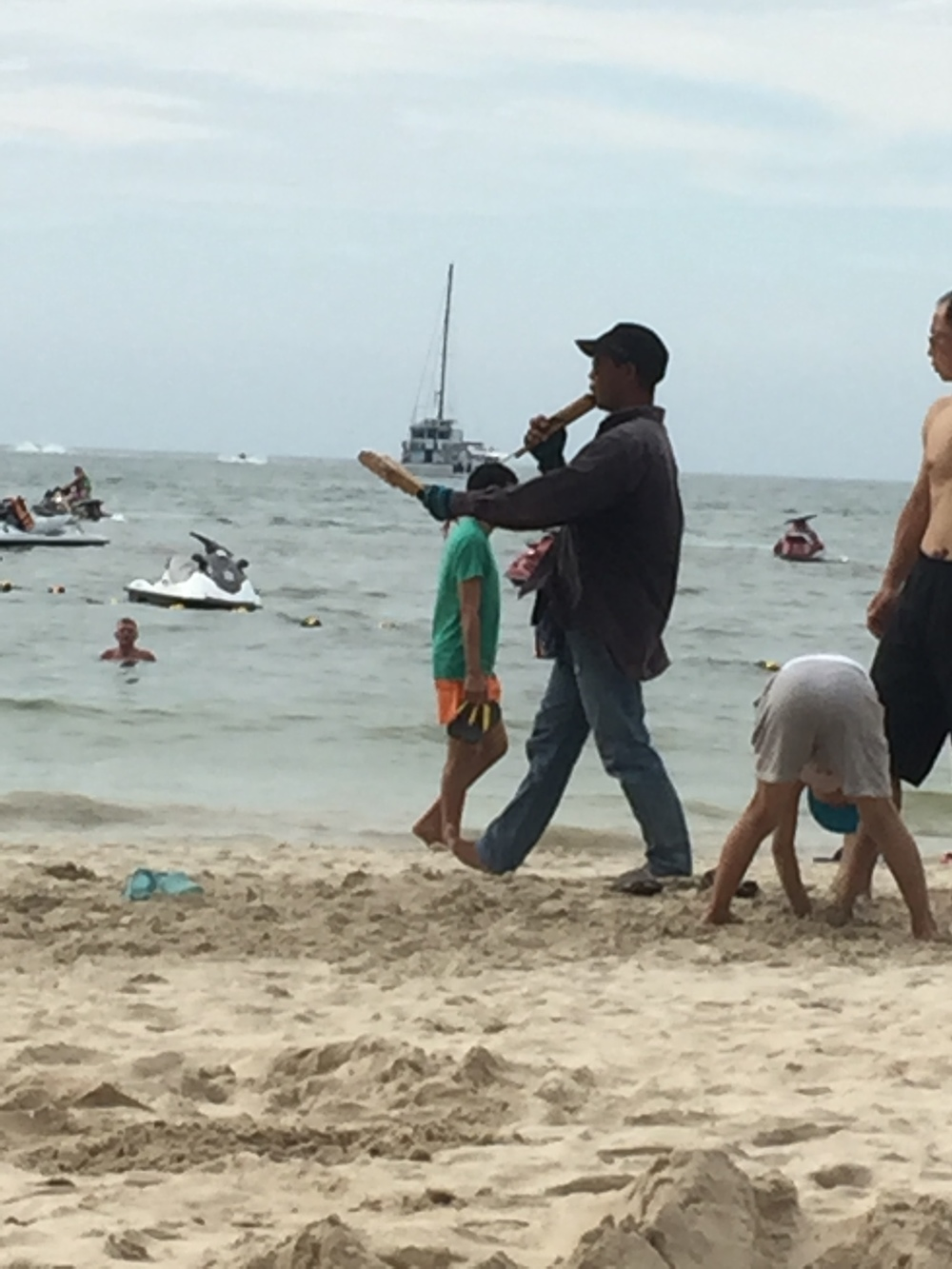 Selling stuff on the beach. These flute things sounded cool, but don't make eye contact or he'll think you want one.