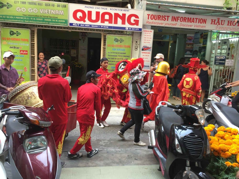 Costumed drummers making a ruckus (for the new year holiday I assume)