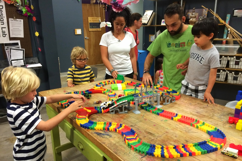 """Visitors and staff enjoy building with the Makery's """"Neo Tracks"""""""
