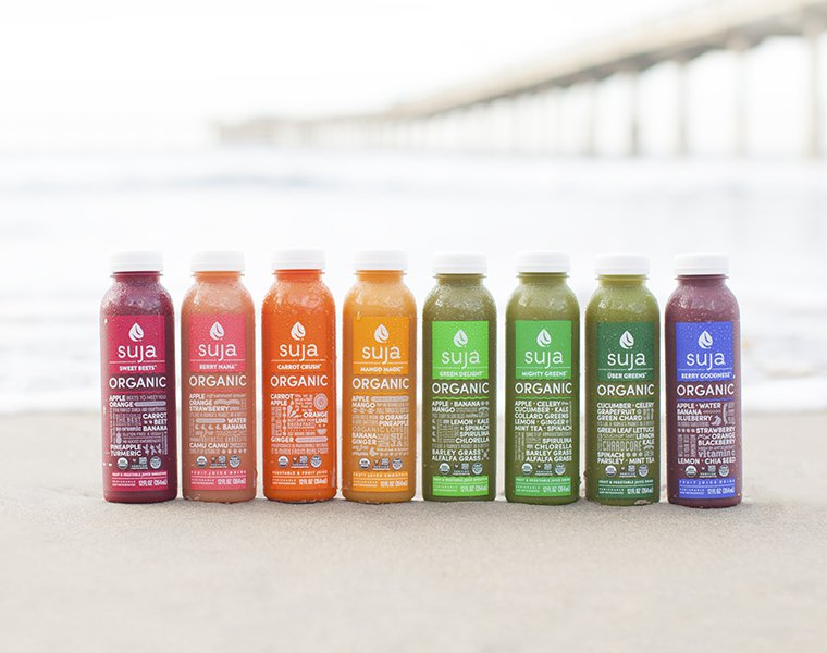 Suja Essentials At Suja we believe that best-quality, clean juice is a grocery not a luxury. We're talking cold-pressed, always organic, never (ever) GMO, chemical-free, filler-free, gluten-free, preservative-free, juice without the junk. Because if it's not all of those things, it's not worth it. Get some Suja in you. So you can get back to living a long, beautiful life.