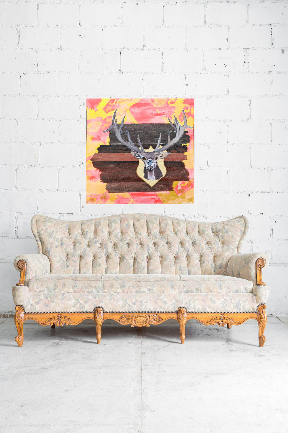 pink deerwood vintage sofa white brick wall.jpg