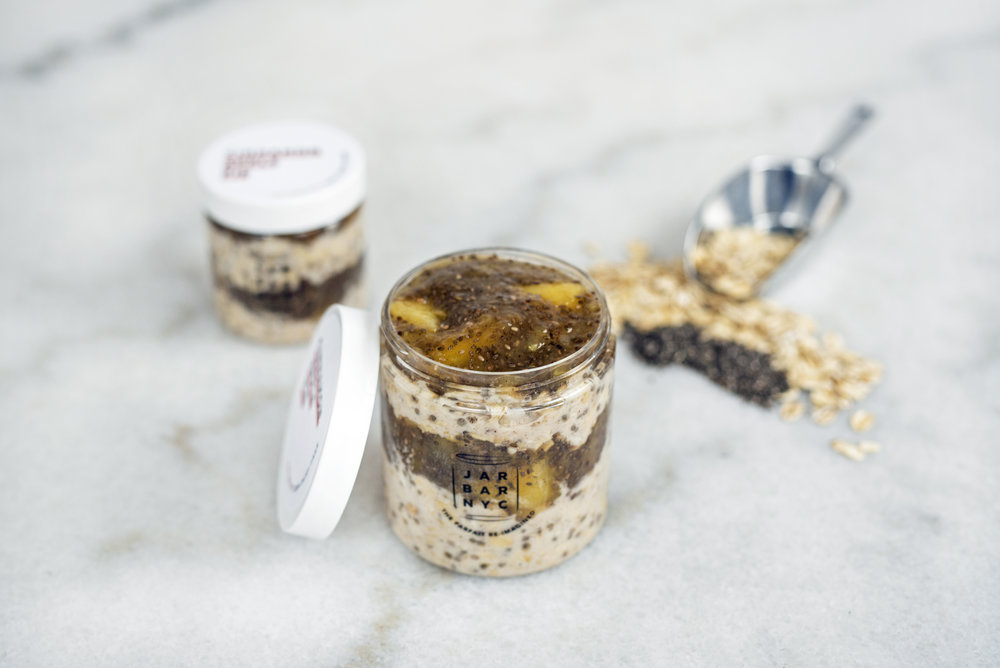 CINNAMON APPLE PIE JAR : apple jam layered with almond butter overnight oats.  Ingredients: apples, apple juice, chia seeds, oatmeal, unsweetened plain almond milk, almond butter, cinnamon, organic amber agave, fine sea salt.