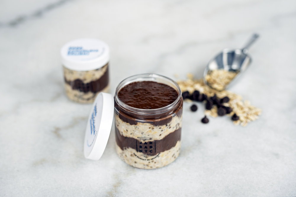 DARK CHOCOLATE DELIGHT JAR : chocolate chia pudding layered with almond butter overnight oats.  Ingredients: organic raw cacao powder, chia seeds, oatmeal, unsweetened plain almond milk, organic amber agave, fine sea salt.