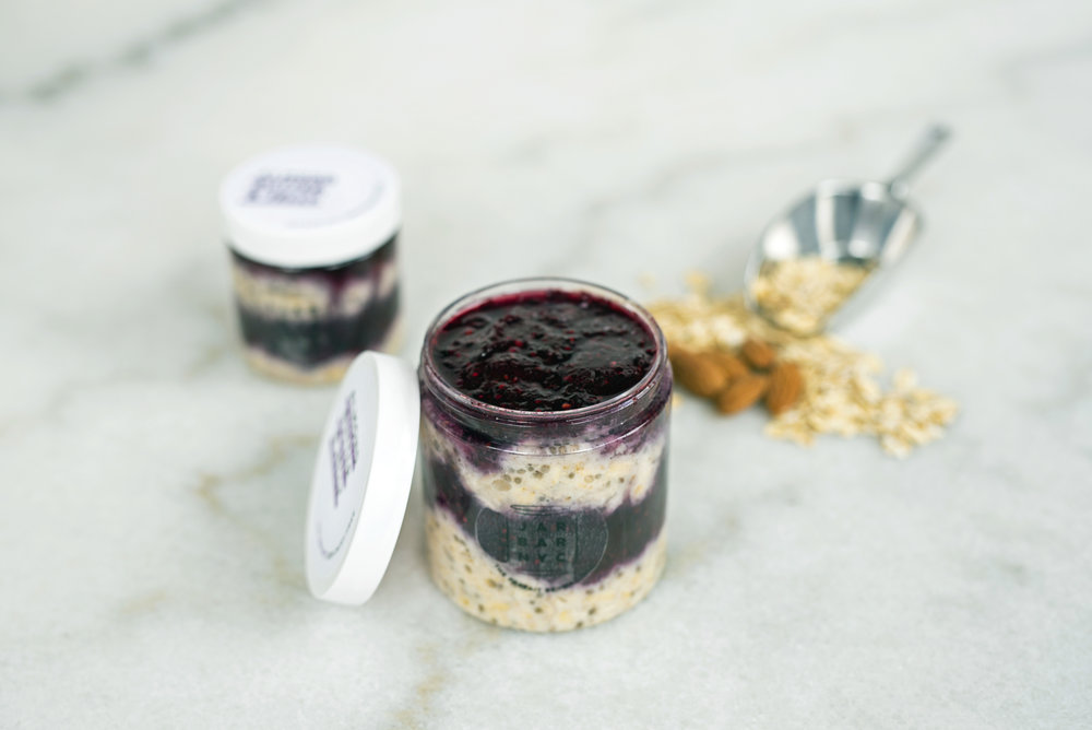 ALMOND BUTTER & JELLY JAR : mixed berry chia jam layered with almond butter overnight oats.  Ingredients: mixed berries, chia seeds, oatmeal, unsweetened plain almond milk, almond butter, cinnamon, organic amber agave, fine sea salt.