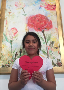 A young artist participates in #HeartsforArt in front of He Gave Her a Rose by Sondra Murphy, oil on canvas