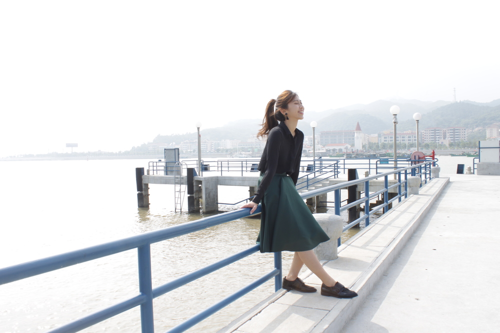 H&M black sheer blouse / Amber (HK) green midi skirt / Vanishing Elephant black pony hair loafers / DearPostman black tassels earrings