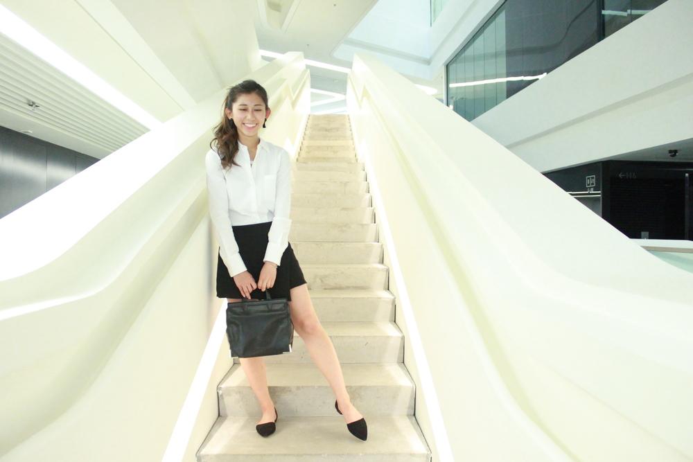 Theory white shirt / Mois studio black uneven skirt / Mango slides / Alexander Wang handbag