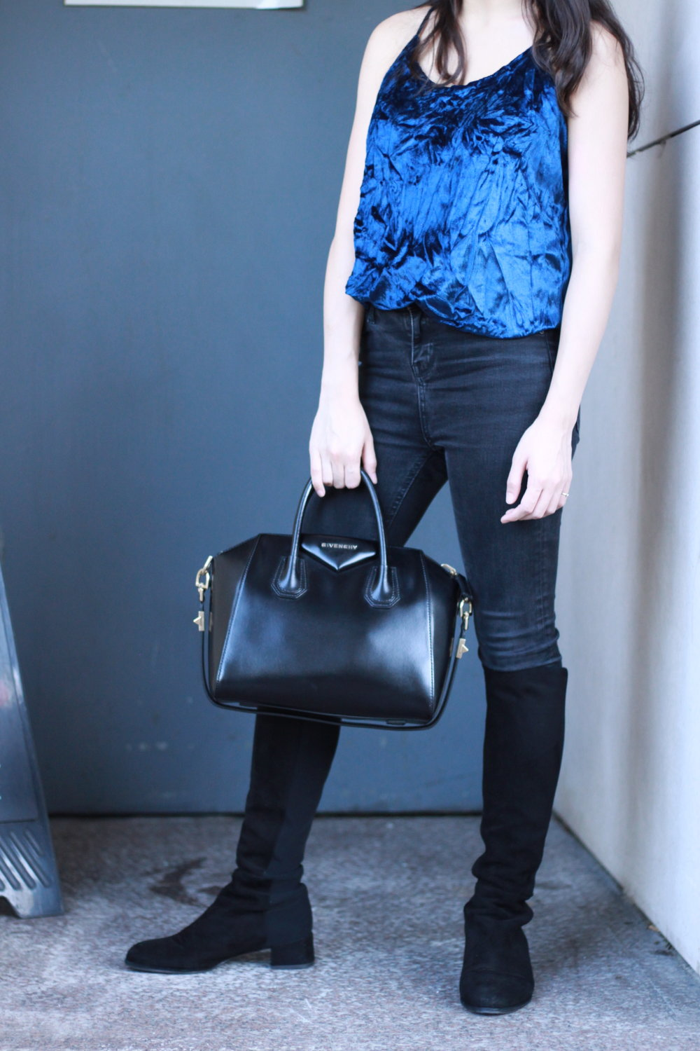 On JongSin: Velvet top / Denim jeans / Stewart Weitzman over-the-knee boots / Givenchy