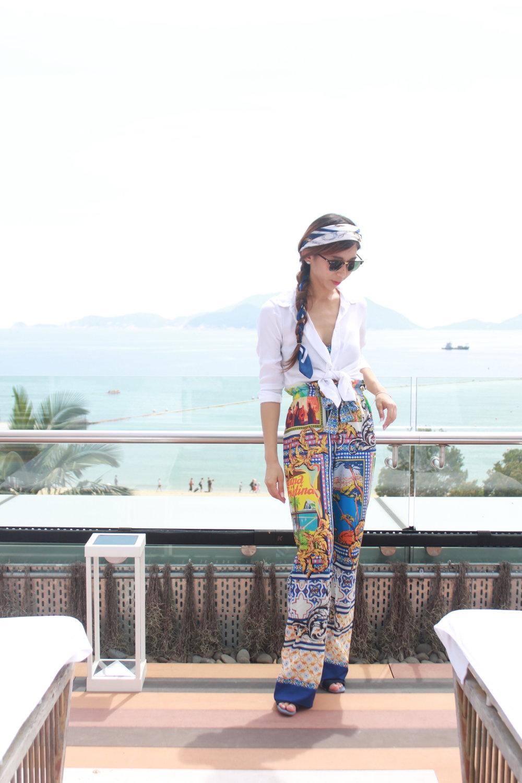 Victoria Secret blue bikini bandeau top / Asos Paperbag Waist Postcard Print Palazzo Trousers Co-ord  / H&M white shirt / Zara blue mules / Scarf / Rayban clubmaster