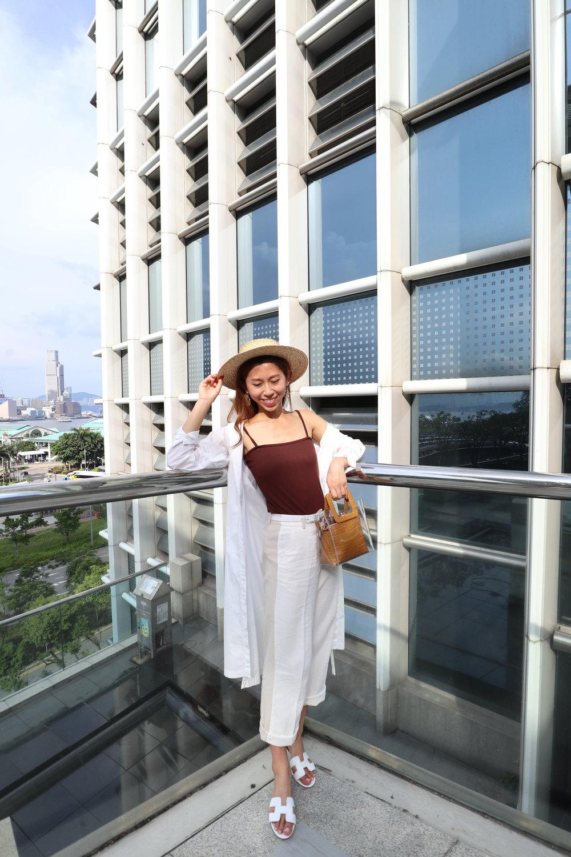 StudioDoe brown cami /Studiodoe beige pants / White shirt from Japan / Staud mini shirley bag clear (tan faux) / Hermes Oasis sandals / Lack of Color the Spencer Boater