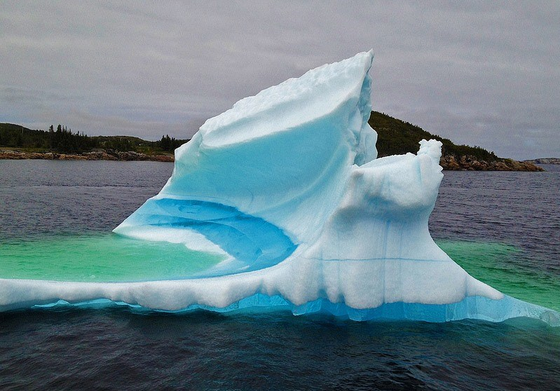 malformalady :      Iceberg, St. John's, North Atlantic.  The bluish streaks in some Icebergs are caused by the the refreezing of meltwater which fills crevasses formed in the glacier(that creates the Iceberg. In other cases, the crevasses or holes (full of air) turn a deep blue.